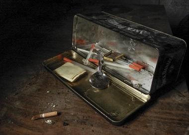 Drug paraphernalia in a dirty box